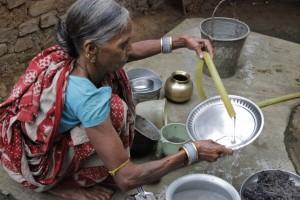 Utam Jani washing dishes